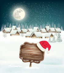 Winter holiday christmas background with a village, a sign and a