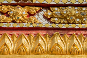 wall carving art with stained glass in the temple ,Thailand