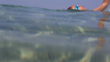 Little girl swimming in the Aegean Sea.
