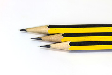 Wooden pencil on a white background