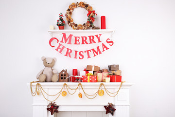 """Decorated Christmas fireplace with inscription """"Merry"""