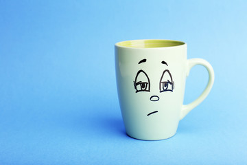 Emotional cup on blue background