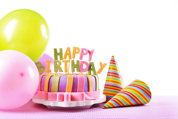 Delicious birthday cake on table on white background