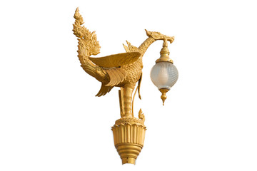 Gold bird statue lamp in temple isolate on white background