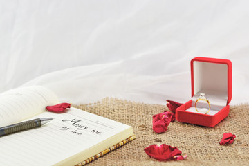 Congratulation write on the Notebook and Dimond Ring.