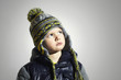 serious child.winter fashion kids.little boy in cap