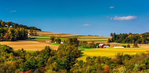 View of rolling hills and farm fields in the rural countryside o