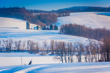 View of snow covered farm fields and houses in rural York County