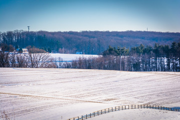 View of snow-covered farm fields in rural York County, Pennsylva