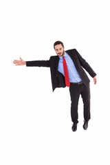 Serious businessman in suit gesturing with hand