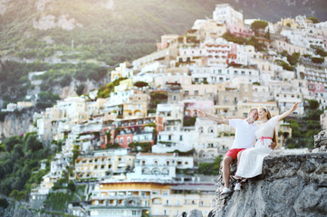 young bride and groom smiling after wedding in Positano, Italy