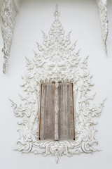 window in Wat Rong khun is known among foreigners as the White T