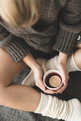 Cute girl holding hot tea