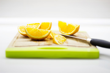 Fresh cutted orange on wooden plank