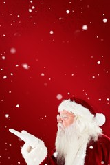 Composite image of santa claus blowing