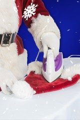 Composite image of father christmas is ironing his hat