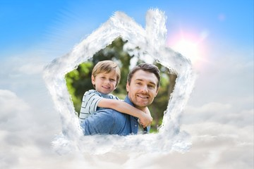 Composite image of father carrying young boy on back at park