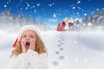 Composite image of festive little girl with hands on face