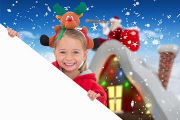 Composite image of festive little girl showing poster