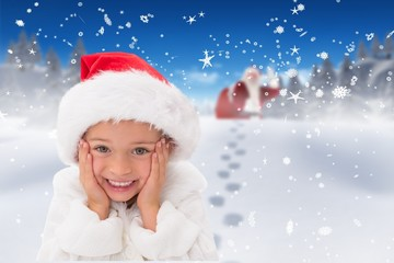 Composite image of cute little girl wearing santa hat