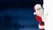 Composite image of smiling santa claus pointing poster