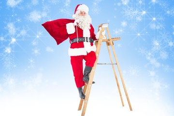 Composite image of santa claus climbing a ladder