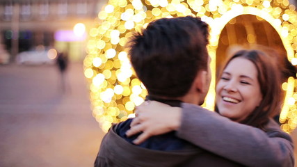 Happy couple hug, turning around, dancing in city