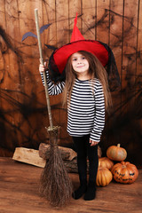 Little girl Witch in hat with broom
