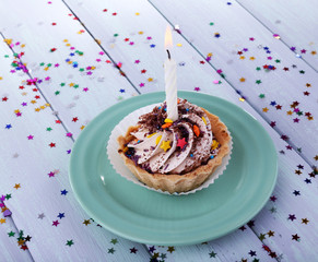 Birthday cup cake with candle with sparkles