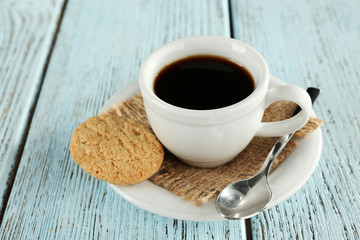 Cup of coffee with burlap cloth, spoon and cookies