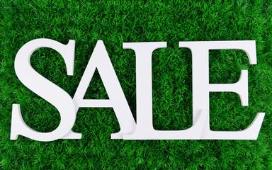 Sale on grass background