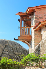 Wooden balcony with hook for lifting things inMeteora, Greece