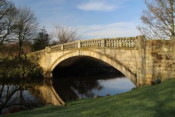 Bridge over White Cart Water in Pollok park, Glasgow, Scotland.