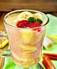 Dessert milk strawberry and banana on board