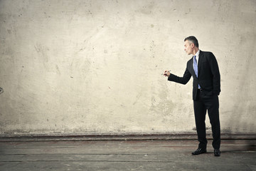 Businessman drawing something on a wall