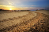 Motocross and auto sport track with sunset sky background.