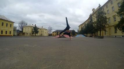 Teenager dancing breakdance in the skate park, 4K