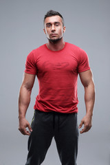 Portrait of a young serious man in red t-shirt