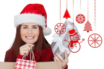 Composite image of woman with gifts