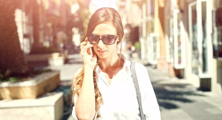 Beautiful Young Female Businesswoman Talking On Cellphone