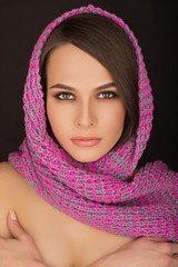 portrait of beautiful girl with a scarf on her head