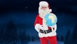 Composite image of happy santa claus holding a globe