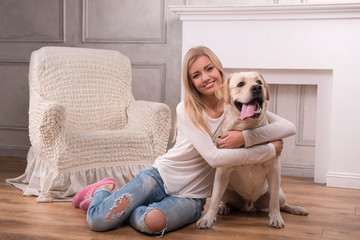 Beautiful  blond girl with Labrador Retriever