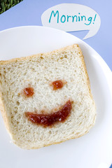 smiley face on bread with morning note