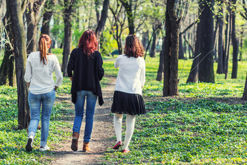 Three women walking away