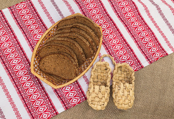 Pair of bast shoes and pieces of rye bread