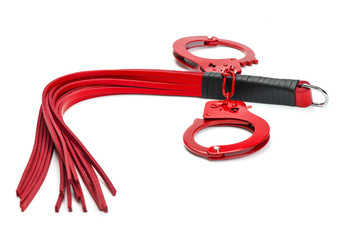 Fetish stuff: leather whip and hand cuffs in red