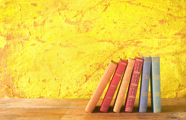 row of books, grungy background, free copy space