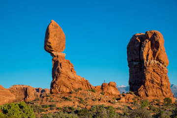Silhouette climbing Balanced rock in Arches National Park, Utah