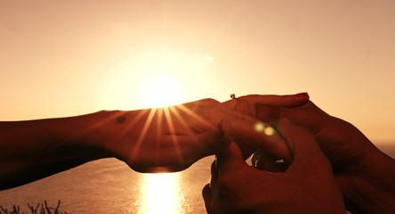 Marriage Proposal Putting Ring On Hand Finger At Sunset Close Up